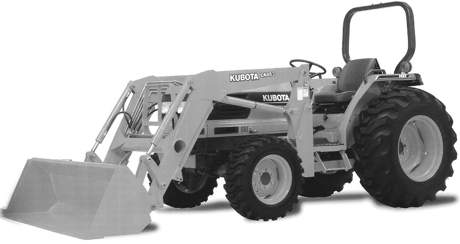 Kubota Tractor Black And White : Digging a hole